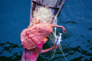 Woman fishing in Bangladesh